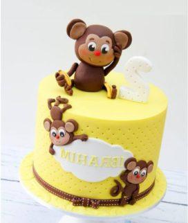 Желтый торт с обезьянками Фото