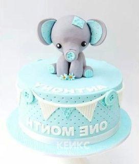 Голубой торт со слоненком Фото