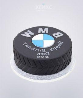 Торт в виде колеса с логотипом БМВ Фото