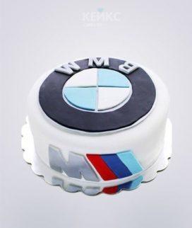 Белый торт с эмблемой БМВ Фото