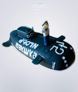 Торт в виде черной подводной лодки с надписью и матросом Фото