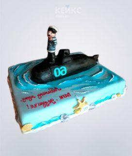 Квадратный торт в виде моря с подводной лодкой и матросом Фото
