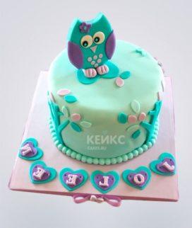 Торт бирюзовый с совенком и лепестками Фото