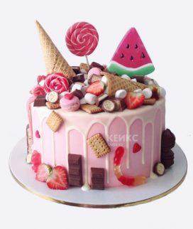 Торт с разными сладостями и долькой арбуза Фото